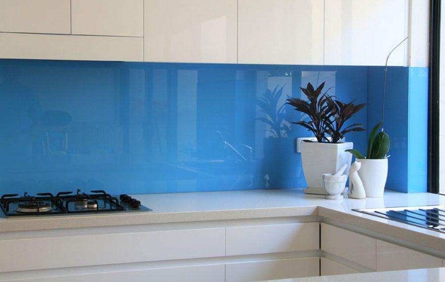 Blue coloured glass splashback in a kitchen
